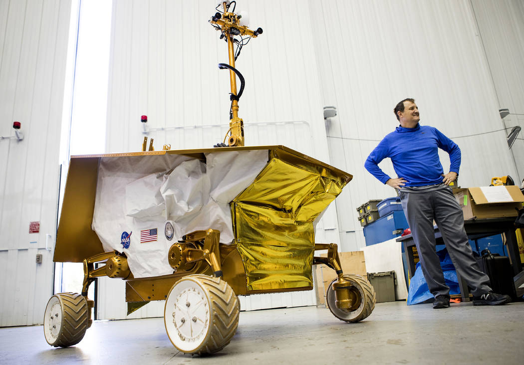 In this Thursday, Nov. 30, 2017 photo, Bill Bluethmann, PhD talks about the Resource Prospector 2015 (RP15) Rover Prototype at the Johnson Space Center , in Houston. The rover is designed to drill ...