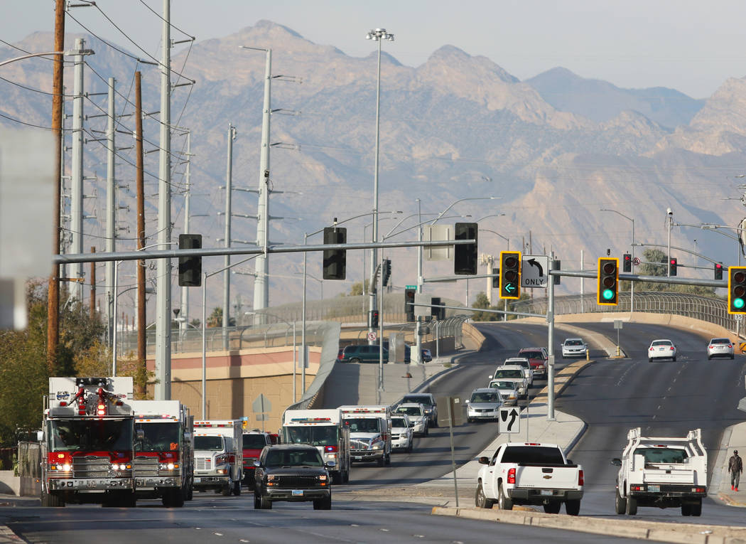 North Las Vegas Fire Department emergency vehicles make their way to the Desert Palms Apartments to surprise families with toys on Sunday, Dec. 24, 2017, in North Las Vegas. Ronda Churchill/Las Ve ...