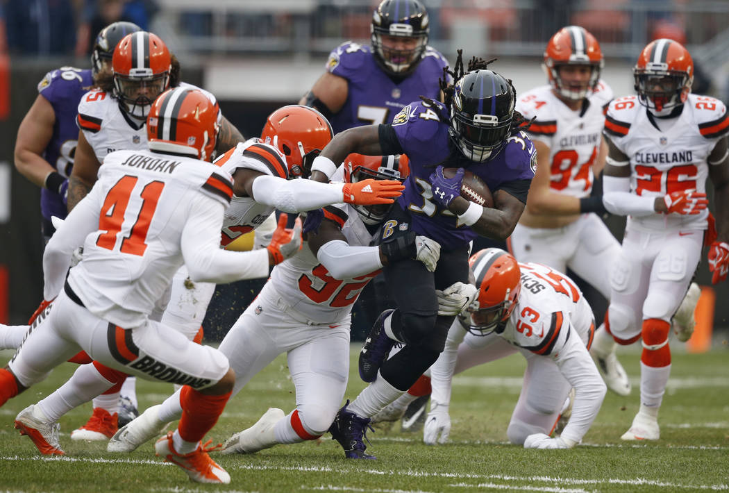 Baltimore Ravens running back Alex Collins (34) rushes against the Cleveland Browns during the first half of an NFL football game, Sunday, Dec. 17, 2017, in Cleveland. (AP Photo/Ron Schwane)