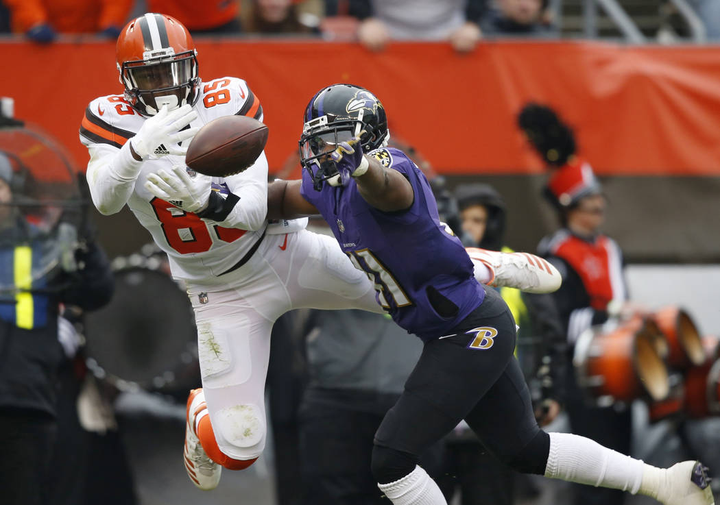 Baltimore Ravens cornerback Anthony Levine, right, breaks up a pass intended for Cleveland Browns tight end David Njoku (85) during the first half of an NFL football game, Sunday, Dec. 17, 2017, i ...