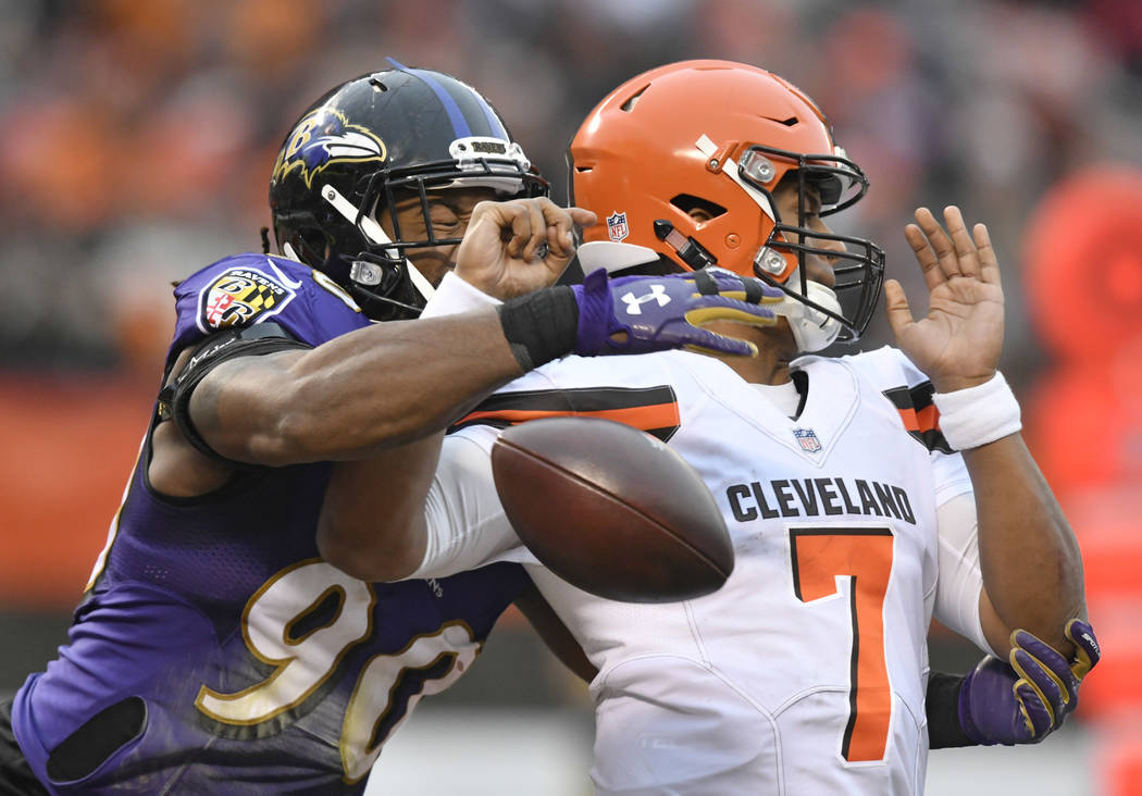Baltimore Ravens defensive end Za'Darius Smith (90) knocks the ball loose from Cleveland Browns quarterback DeShone Kizer (7) during the second half of an NFL football game, Sunday, Dec. 17, 2017, ...