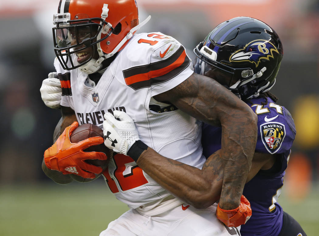 Baltimore Ravens cornerback Brandon Carr (24) tackles Cleveland Browns wide receiver Josh Gordon (12) during the second half of an NFL football game, Sunday, Dec. 17, 2017, in Cleveland. (AP Photo ...