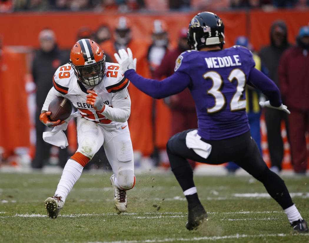 Baltimore Ravens defensive back Marlon Humphrey (29) tries to avoid Baltimore Ravens free safety Eric Weddle (32) during the second half of an NFL football game, Sunday, Dec. 17, 2017, in Clevelan ...