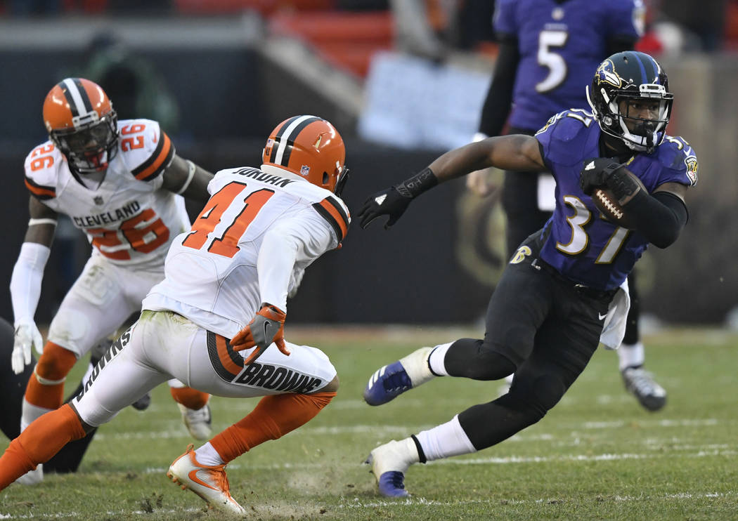 Baltimore Ravens running back Javorius Allen (37) rushes against the Cleveland Browns during the second half of an NFL football game, Sunday, Dec. 17, 2017, in Cleveland. (AP Photo/David Richard)