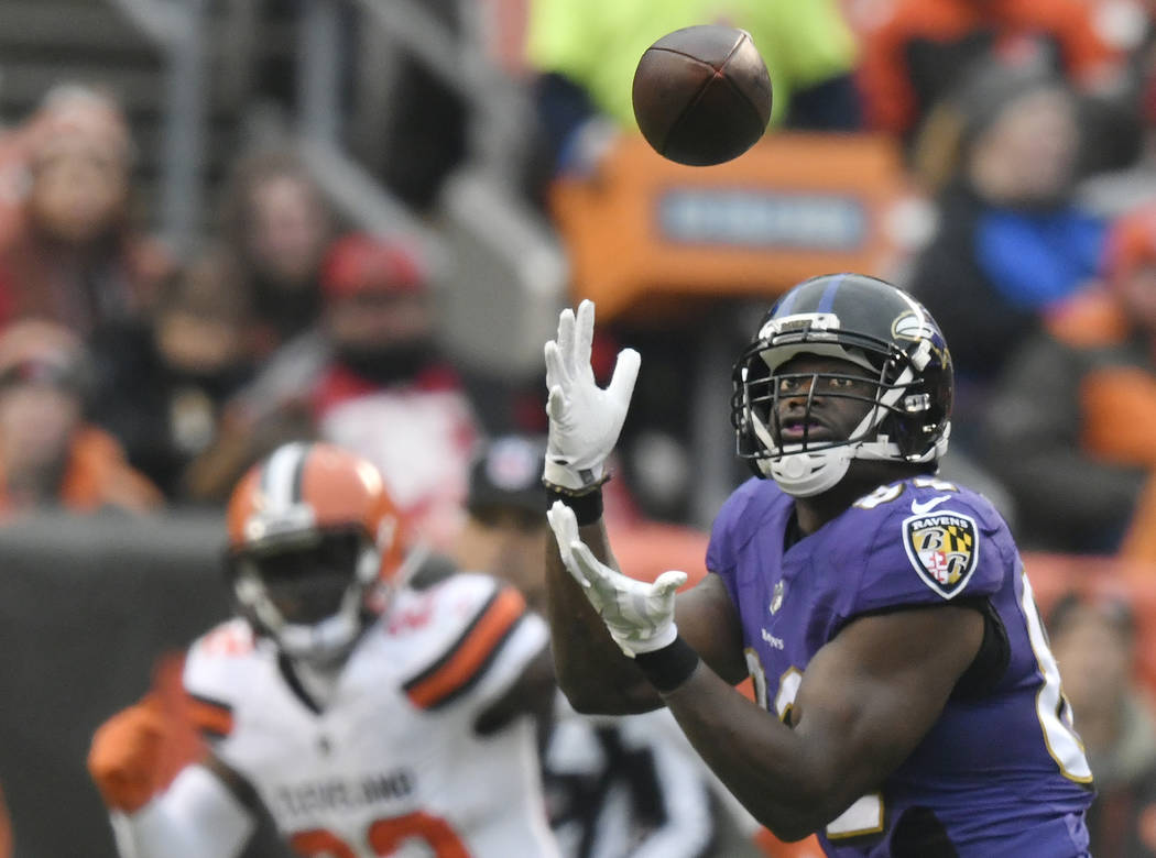 Baltimore Ravens tight end Benjamin Watson catches a pass for a 33-yard touchdown during the first half of an NFL football game against the Cleveland Browns, Sunday, Dec. 17, 2017, in Cleveland. B ...
