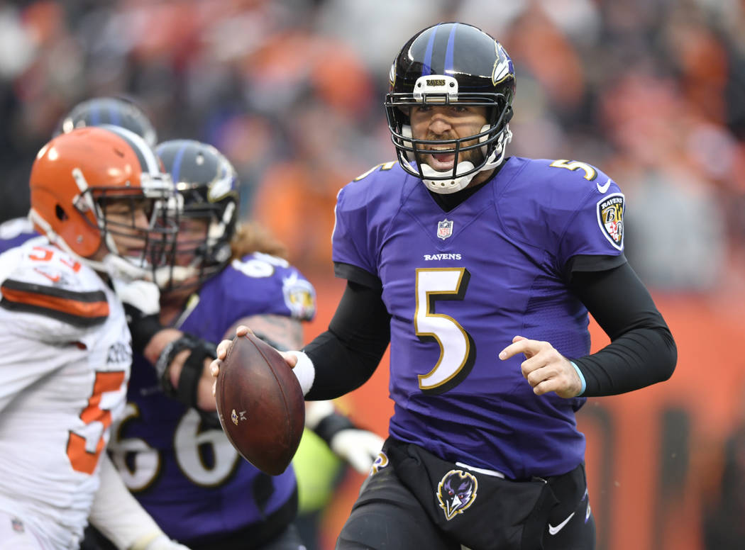 Baltimore Ravens quarterback Joe Flacco rushes for a 2-yard touchdown during the first half of an NFL football game against the Cleveland Browns, Sunday, Dec. 17, 2017, in Cleveland. Baltimore won ...
