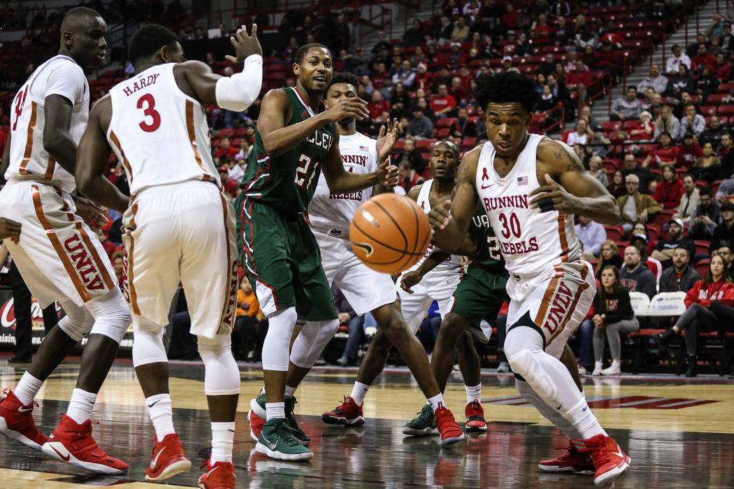 Mississippi Valley State Delta Devils forward Arinze Anakwenze (21) and UNLV Rebels guard Jovan Mooring (30) stare down the basketball during the first half of a basketball game at the Thomas &amp ...