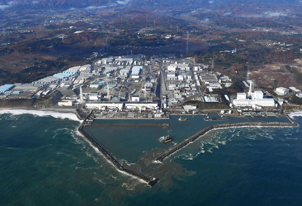 FILE - This Nov. 22, 2016, aerial file photo shows Fukushima Dai-ichi nuclear power plant in Okuma, Fukushima prefecture, Japan. A suspected wartime bomb was dug up at Thursday, Aug. 10, 2017, a c ...