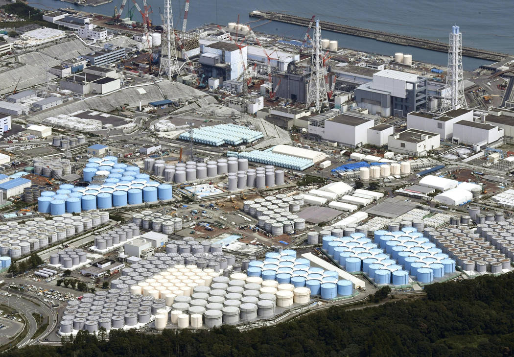 In this Sept. 2017, photo, tanks are seen at Fukushima Dai-ichi nuclear plant in Okuma.  More than six years after a tsunami overwhelmed the Fukushima nuclear power plant, Japan has yet to reach c ...