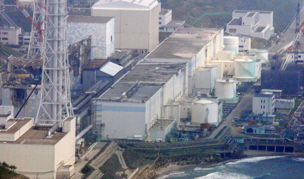 FILE - In this May 28, 2012 aerial file photo, reactors of the tsunami-stricken Fukushima Dai-ichi nuclear power plant stand in Okuma, Fukushima Prefecture, northeastern Japan. An underwater robot ...