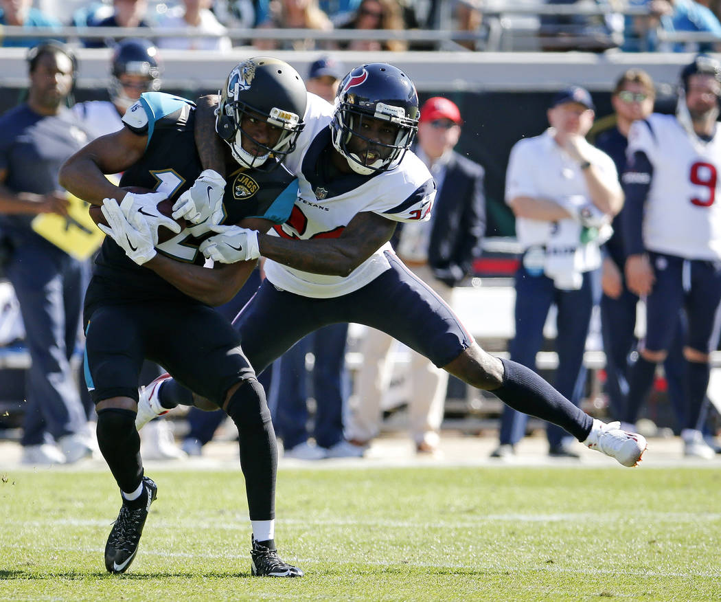 Jacksonville Jaguars wide receiver Dede Westbrook, left, makes a reception in front of Houston Texans cornerback Johnathan Joseph during the first half of an NFL football game, Sunday, Dec. 17, 20 ...