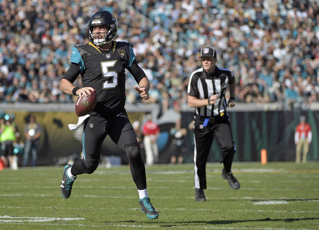 Jacksonville Jaguars quarterback Blake Bortles runs against the Houston Texans during the first half of an NFL football game, Sunday, Dec. 17, 2017, in Jacksonville, Fla. (AP Photo/Phelan M. Ebenhack)