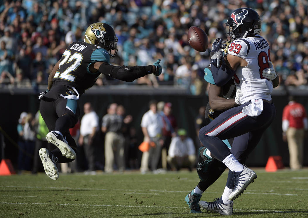 Jacksonville Jaguars cornerback Aaron Colvin (22) breaks up a pass intended for Houston Texans tight end Stephen Anderson (89) during the first half of an NFL football game, Sunday, Dec. 17, 2017, ...