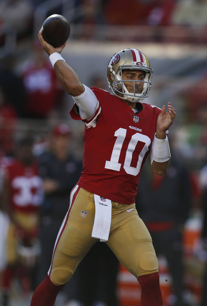San Francisco 49ers quarterback Jimmy Garoppolo (10) throws against the Tennessee Titans during the first half of an NFL football game Sunday, Dec. 17, 2017, in Santa Clara, Calif. (AP Photo/D. Ro ...