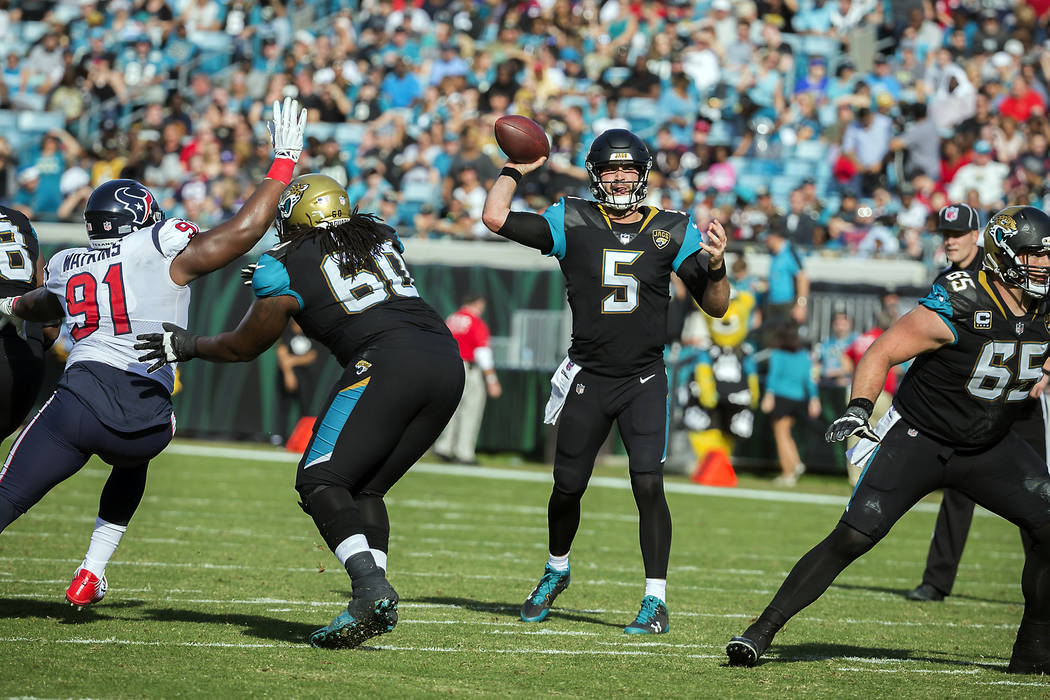 Jacksonville Jaguars quarterback Blake Bortles (5) throws down field against the Houston Texans during the first half of an NFL football game, Sunday, Dec. 17, 2017, in Jacksonville, Fla. (AP Phot ...