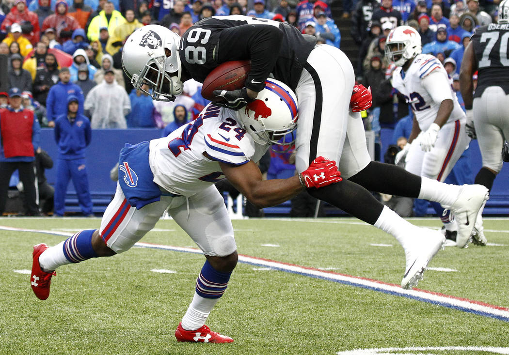 Buffalo Bills defensive back Leonard Johnson (24) makes the hit on Oakland Raiders wide receiver Amari Cooper (89) during the second half of an NFL football game, Sunday, Oct. 29, 2017, in Orchard ...