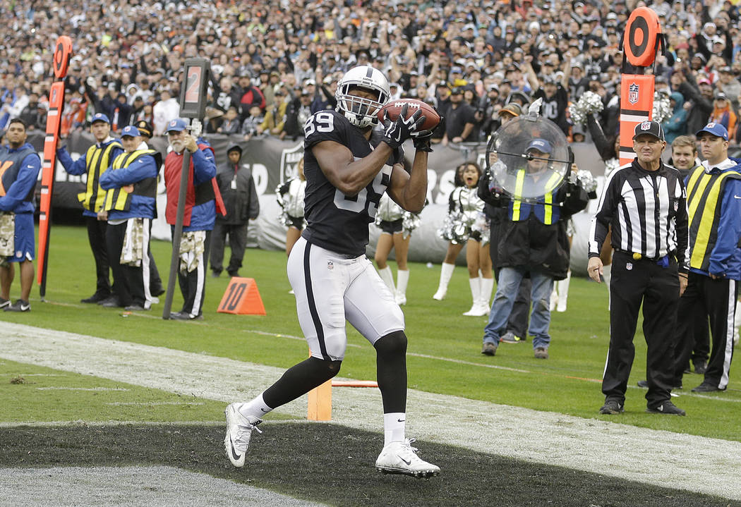Oakland Raiders wide receiver Amari Cooper (89) catches a touchdown pass against the Denver Broncos during the first half of an NFL football game in Oakland, Calif., Sunday, Nov. 26, 2017. (AP Pho ...