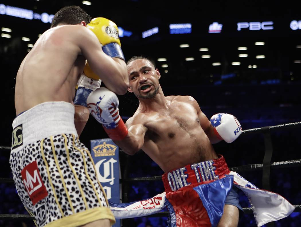 Keith Thurman, right, punches Danny Garcia during the seventh round of a welterweight championship boxing match Saturday, March 4, 2017, in New York. Thurman won the fight. (AP Photo/Frank Frankli ...