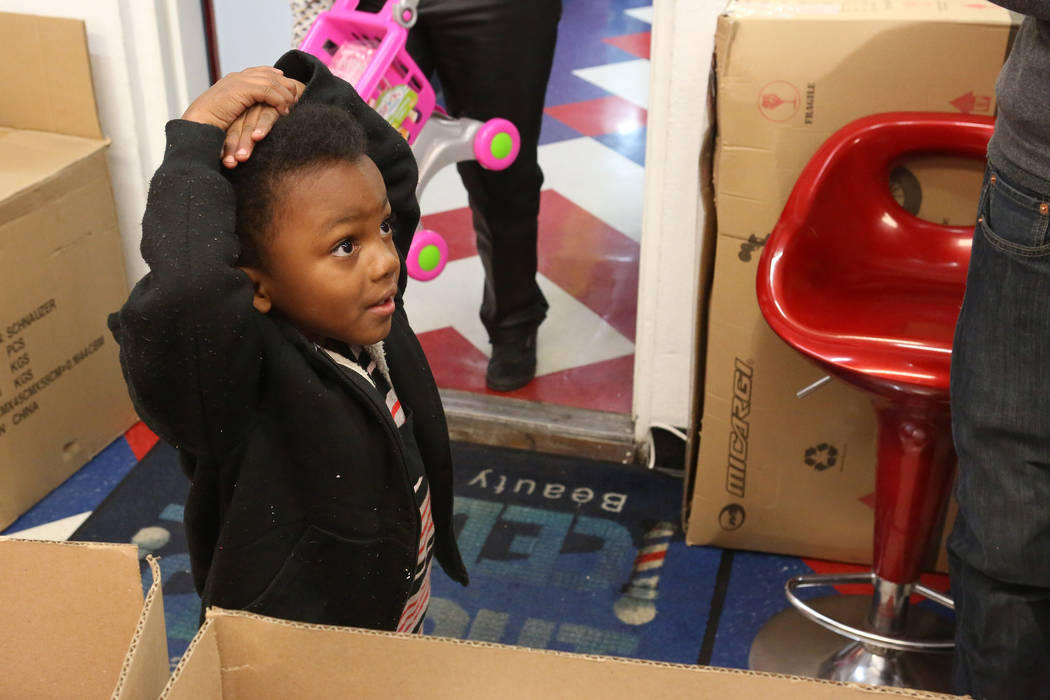 L'ekaree Harrison, 5, waits to pick up his gift at the Mayweather toy giveaway at Iced Out Barber Shop Las Vegas on Friday, Dec. 22, 2017. Michael Quine Las Vegas Review-Journal @Vegas88s