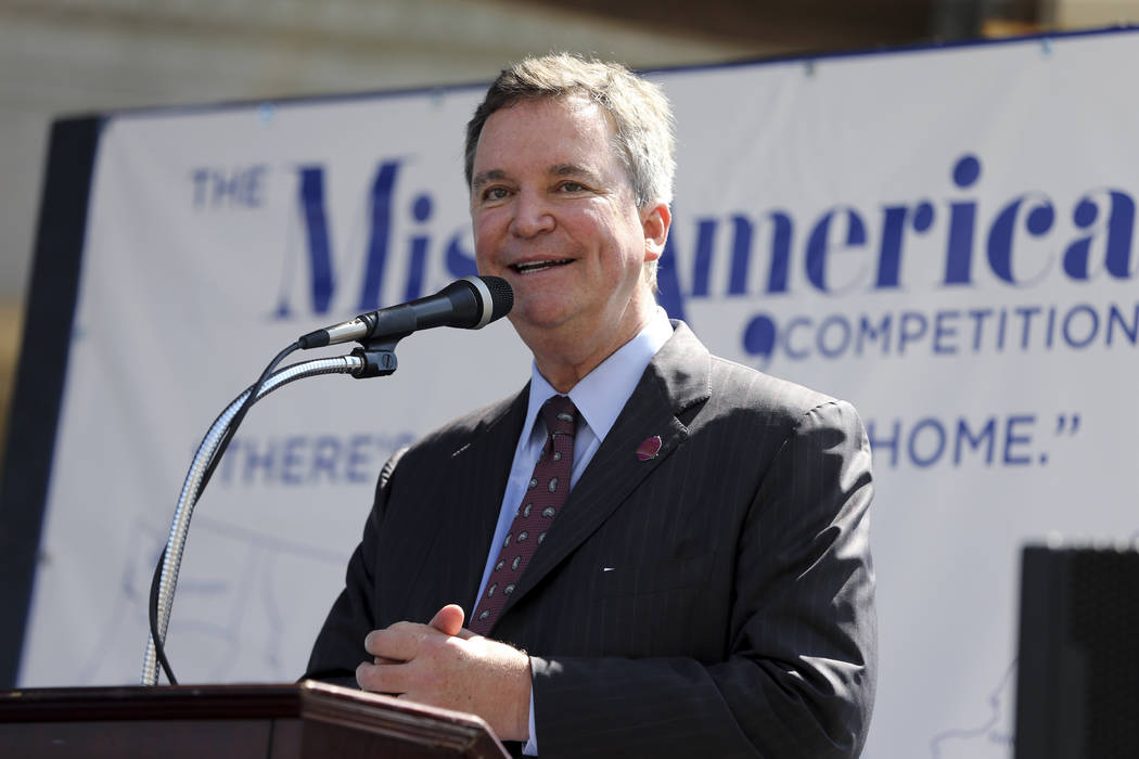 Sam Haskell, left, CEO of Miss America Organization, speaks on Aug. 30, 2016, during Miss America Pageant arrival ceremonies in Atlantic City, N.J. On Thursday Dec. 21, 2017, the Huffington Post p ...