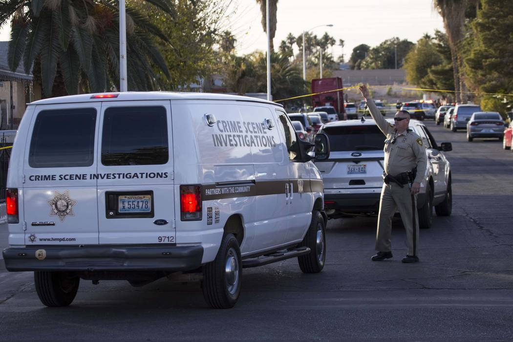 Crime scene investigators arrive at the scene of a triple homicide at the 4300 block of Del Santos Drive in east Las Vegas on Friday, Dec. 22, 2017. (Richard Brian/Las Vegas Review-Journal) @vegas ...