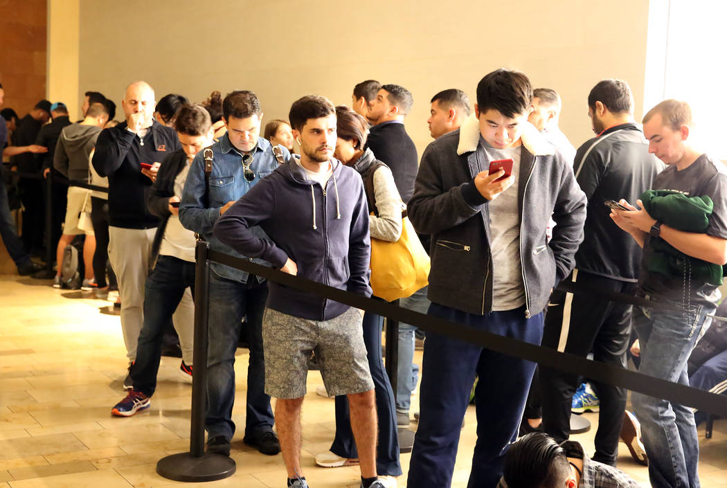 Customers, including Tomas Delucca for Argentina, center, lined up for iPhone X outside the Apple Store on the Las Vegas Strip at Fashion Show Mall on Friday, Nov. 3, 2017. Bizuayehu Tesfaye/Las V ...