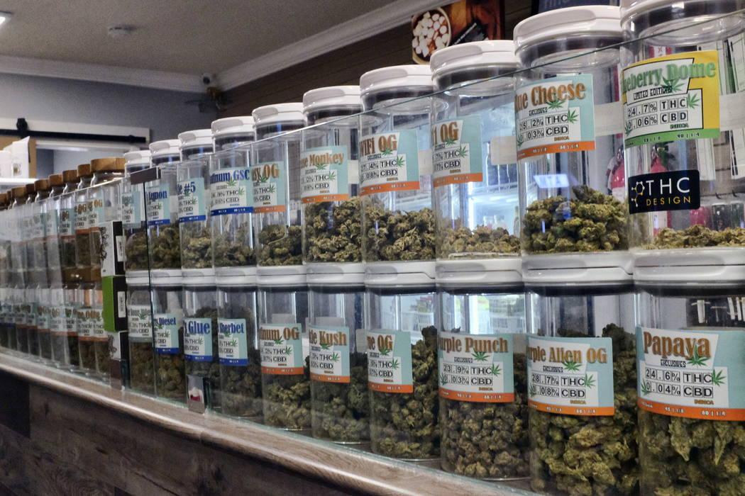 Jars of medical marijuana are seen on the counter of Western Caregivers Medical marijuana dispensary in Los Angeles. (AP Photo/Richard Vogel, File)