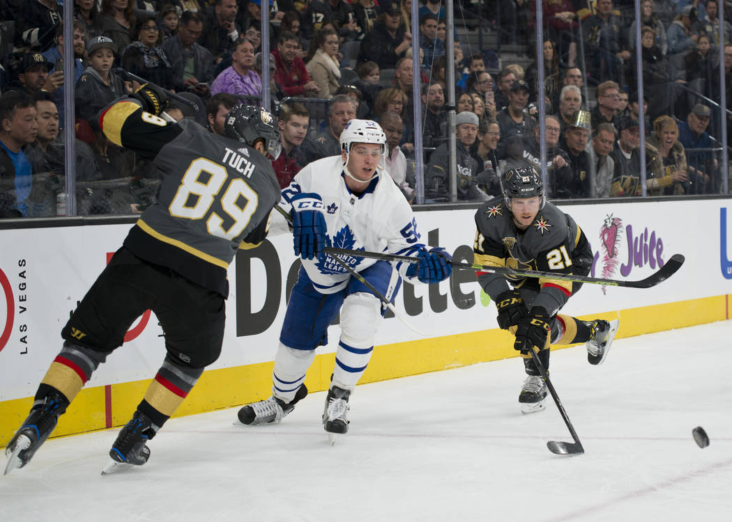 Toronto Maple Leafs defenseman Martin Marincin (52) gets the puck away from Vegas Golden Knights right wing Alex Tuch (89) and center Cody Eakin (21) during their game at T-Mobile Arena in Las Veg ...