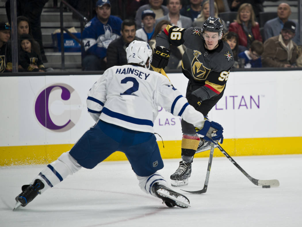 Vegas Golden Knights left wing Erik Haula (56) shoots the puck by Toronto Maple Leafs defenseman Ron Hainsey (2)  to score a goal during their game at T-Mobile Arena in Las Vegas on Sunday, Decemb ...