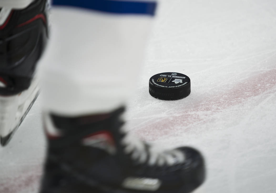 A puck is seen on the ice during the NHL hockey game between the Toronto Maple Leafs and the Vegas Golden Knights at T-Mobile Arena in Las Vegas on Sunday, December 31, 2017. Daniel Clark/Las Vega ...