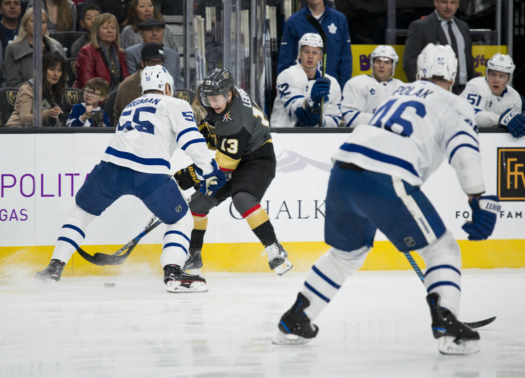 Vegas Golden Knights left wing Brendan Leipsic (13) struggles with Toronto Maple Leafs Andreas Borgman (55) during their game at T-Mobile Arena in Las Vegas on Sunday, December 31, 2017. Daniel Cl ...