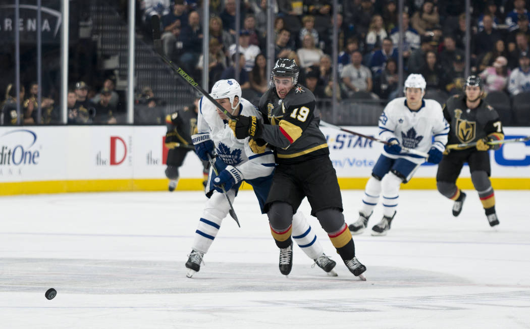 Vegas Golden Knights right ring Reilly Smith (19) races left wing Matt Martin (15) to the puck during their home game against the Toronto Maple Leafs at T-Mobile Arena in Las Vegas on Sunday, Dece ...
