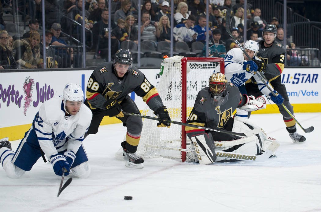 Players scramble for the puck during the NHL hockey game between the Toronto Maple Leafs and the Vegas Golden Knights at T-Mobile Arena in Las Vegas on Sunday, December 31, 2017. Daniel Clark/Las  ...