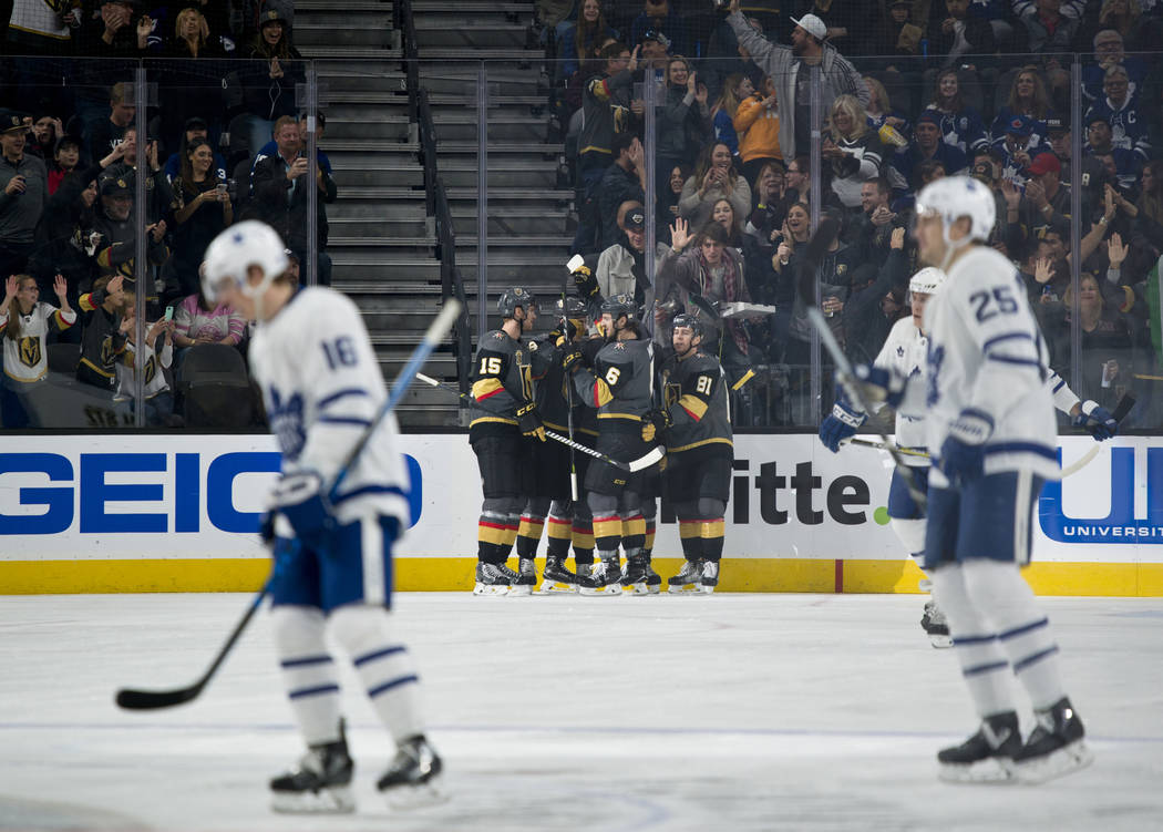 The Vegas Golden Knights celebrate after scoring a goal during their home game against the Toronto Maple Leafs at T-Mobile Arena in Las Vegas on Sunday, December 31, 2017. Daniel Clark/Las Vegas R ...