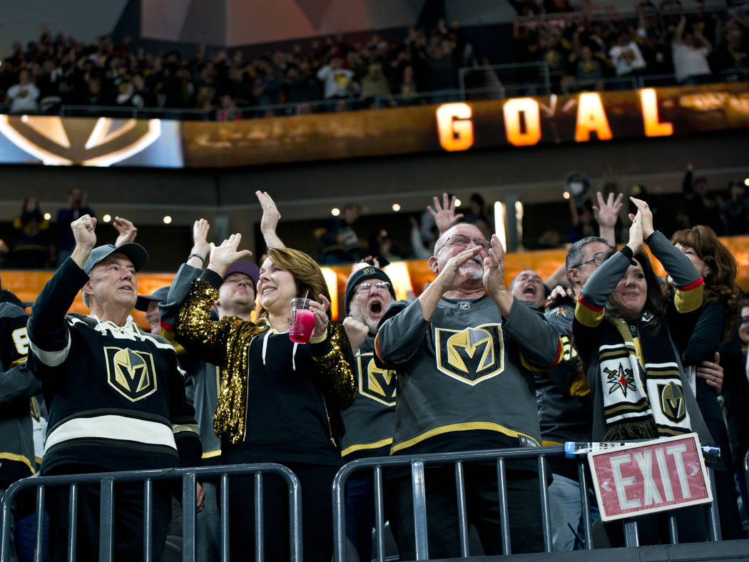 Vegas Golden Knights fans celebrate a goal during the NHL hockey game between the Toronto Maple Leafs and the Vegas Golden Knights at T-Mobile Arena in Las Vegas on Sunday, December 31, 2017. Dani ...