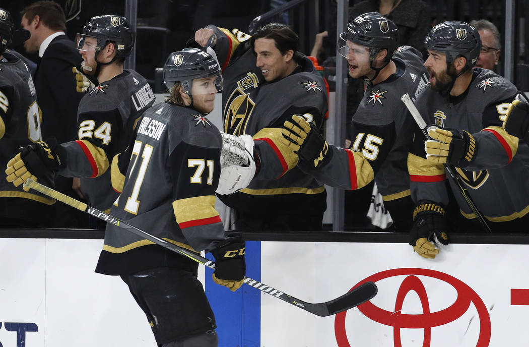 Vegas Golden Knights center William Karlsson (71) celebrates after scoring a hat trick against the Toronto Maple Leafs during the third period of an NHL hockey game, Sunday, Dec. 31, 2017, in Las  ...