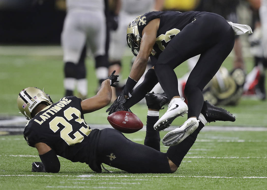 New Orleans Saints cornerback Marshon Lattimore (23) intercepts a throw from Atlanta Falcons quarterback Matt Ryan in the final minute of the second quarter, setting up a Saints touchdown, in an N ...
