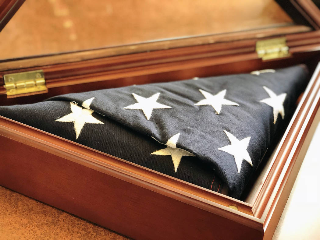 A burial flag, found in the middle of the roadway near Buffalo Drive and Russell Road, is pictured. Joseph Mascolino is hoping to return the flag to the family of the veteran. (Rio Lacanlale/Las V ...