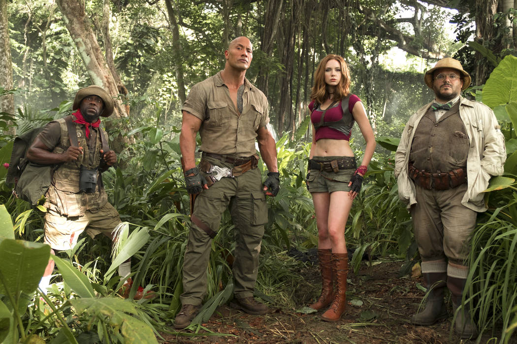 """This image released by Sony Pictures shows Kevin Hart, from left, Dwayne Johnson, Karen Gillan and Jack Black in """"Jumanji: Welcome to the Jungle."""" (Frank Masi/Sony Pictures via AP)"""