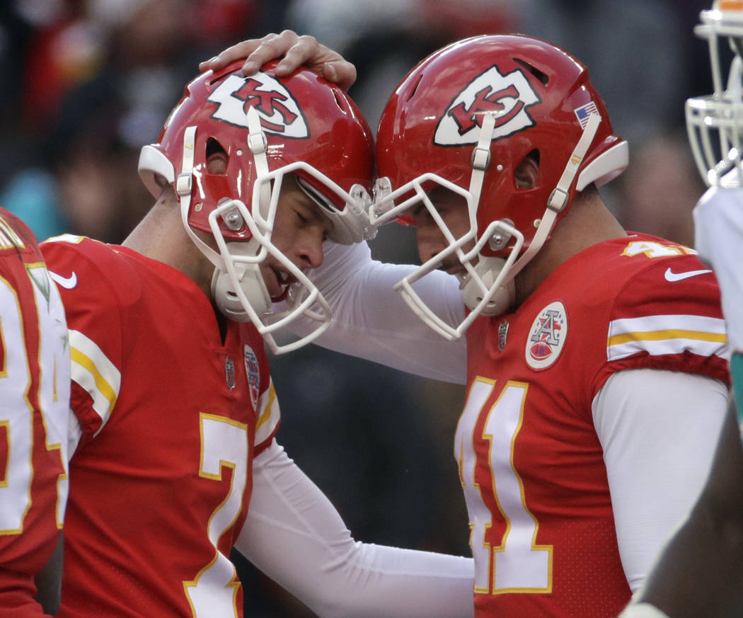 Kansas City Chiefs kicker Harrison Butker (7) is congratulated by quarterback Alex Smith (11) after he scored a field goal during the first half of an NFL football game against the Miami Dolphins  ...