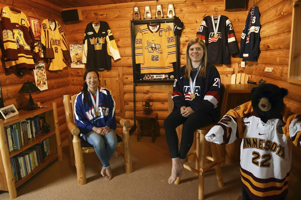 In this May 11, 2017 photo, sisters Marissa, left, and Hannah Brandt, pose in their family home in Vadnais Heights. Minn. The pair will be playing in the upcoming Winter Olympics in women's hockey ...