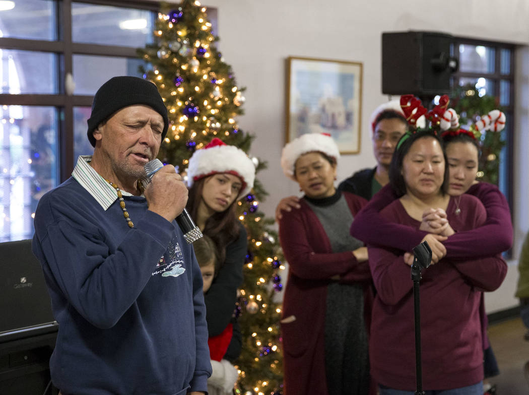 """Warren Enoch, who is currently homeless and living in a shelter, karaokes """"She Believes In Me"""" by Kenny Rogers during Christmas dinner at Catholic Charities of Southern Nevada St ..."""