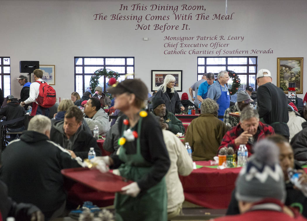 Guests eat Christmas dinner at Catholic Charities of Southern Nevada on Monday, Dec. 25, 2017, in Las Vegas. More than 100 volunteers served approximately 1000 Christmas meals to Sourthern Nevada' ...
