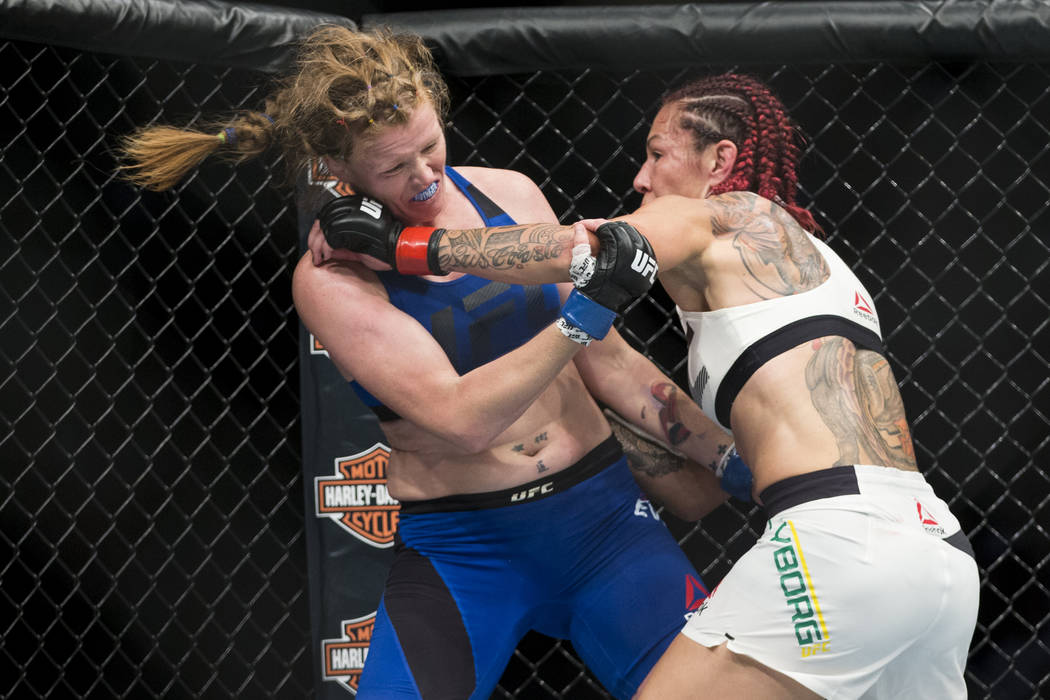 """Cris """"Cyborg"""" Justino, right, battles against Tonya Evinger in the womenճ featherweight title bout during UFC 214 at the Honda Center in Anaheim, Calif., on Saturday, July 29, 2017. Justino won b ..."""