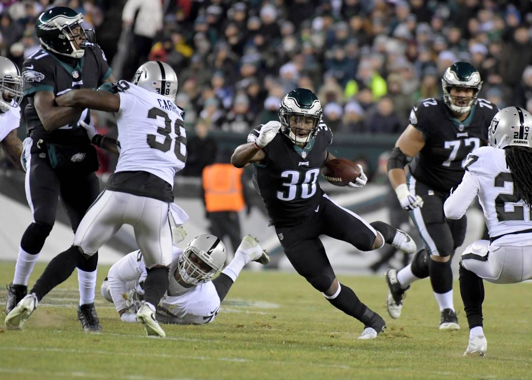 Dec 25, 2017; Philadelphia, PA, USA; Philadelphia Eagles running back Corey Clement (30) carries the ball past Oakland Raiders cornerback T.J. Carrie (38) during an NFL football game at Lincoln Fi ...