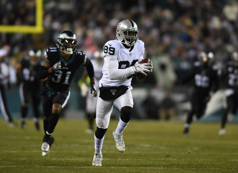 Dec 25, 2017; Philadelphia, PA, USA; Oakland Raiders wide receiver Amari Cooper (89) carries the ball after the catch en route to scoring a touchdown as Philadelphia Eagles cornerback Jalen Mills  ...