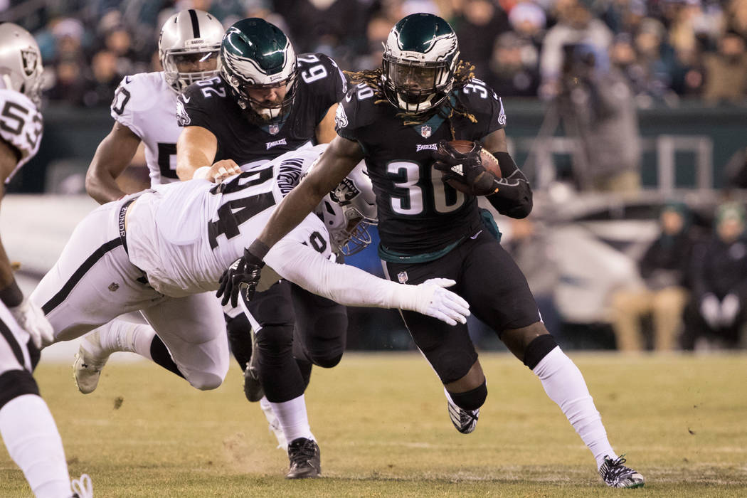 Dec 25, 2017; Philadelphia, PA, USA; Philadelphia Eagles running back Jay Ajayi (36) breaks the tackle attempt of Oakland Raiders defensive tackle Eddie Vanderdoes (94) during the first quarter at ...
