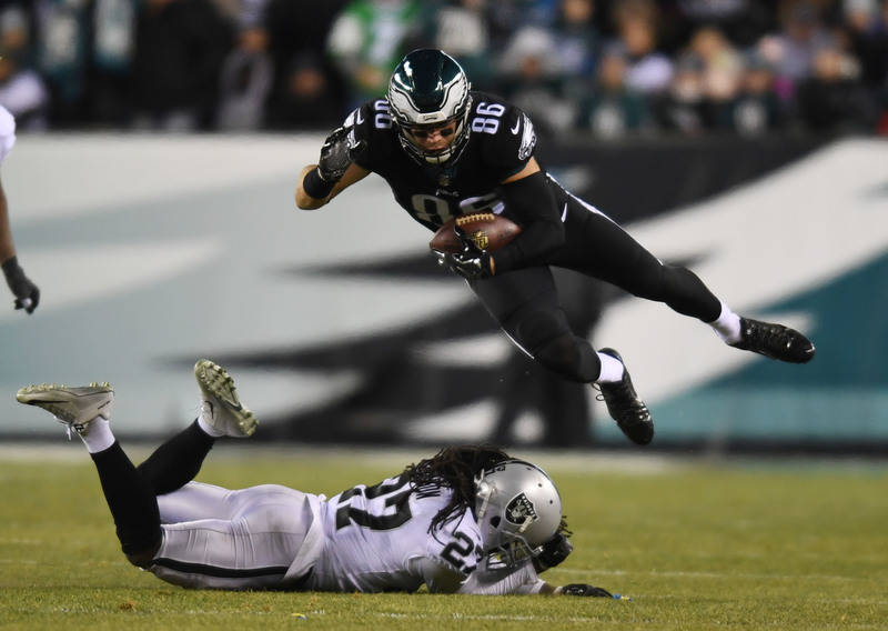 Dec 25, 2017; Philadelphia, PA, USA; Philadelphia Eagles tight end Zach Ertz (86) falls to the ground as Oakland Raiders free safety Reggie Nelson (27) defends in the second quarter at Lincoln Fin ...