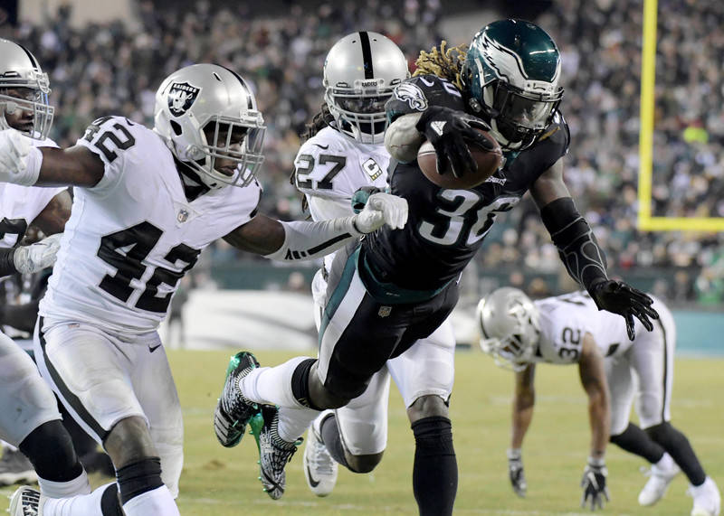 Dec 25, 2017; Philadelphia, PA, USA; Philadelphia Eagles running back Jay Ajayi (36) dives into the end zone for a touchdown past Oakland Raiders strong safety Karl Joseph (42) during an NFL footb ...