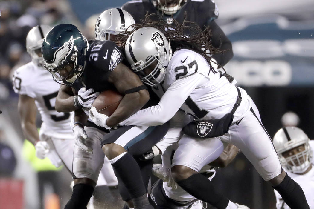 Philadelphia Eagles' Corey Clement (30) rushes against Oakland Raiders' Reggie Nelson (27) during the first half of an NFL football game, Monday, Dec. 25, 2017, in Philadelphia. (AP Photo/Michael  ...
